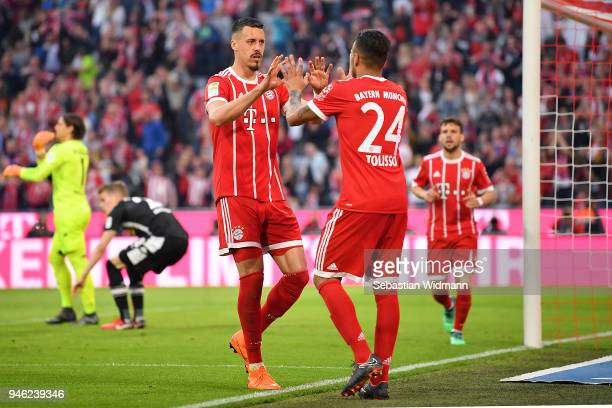 Sandro Wagner of Muenchen celebrates with Tolisso of Bayern Muenchen after Thiago Alcantara of Bayern Muenchen scored a goal to make it 31 during the...