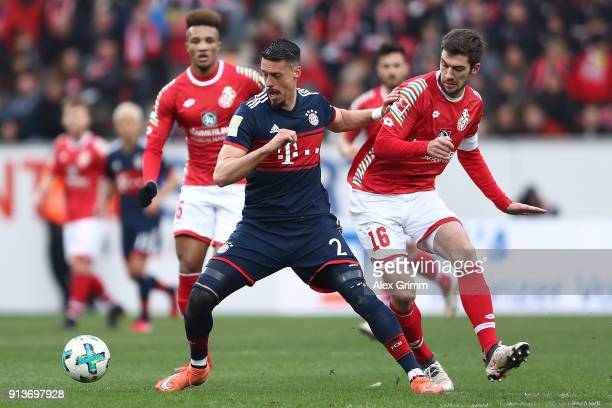 Sandro Wagner of Muenchen fights for the ball with Stefan Bell of Mainz during the Bundesliga match between 1 FSV Mainz 05 and FC Bayern Muenchen at...