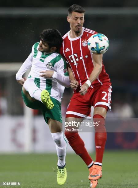 Sandro Wagner of Muenchen is challenged by Al Abbasi of Al Ahli during the friendly match between AlAhli and Bayern Muenchen on day 5 of the FC...