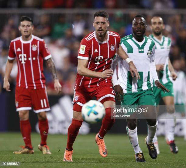 Sandro Wagner of Muenchen is challenged by John Benson of Al Ahli during the friendly match between AlAhli and Bayern Muenchen on day 5 of the FC...