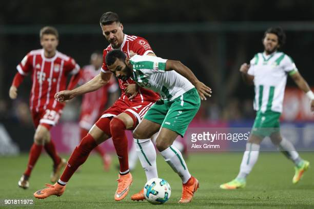 Sandro Wagner of Muenchen is challenged by Khalil Shreff of Al Ahli during the friendly match between AlAhli and Bayern Muenchen on day 5 of the FC...