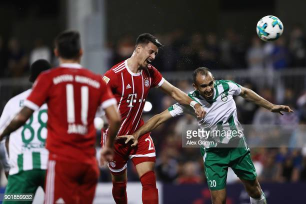Sandro Wagner of Muenchen jumps for a header with H Masri of Al Ahli during the friendly match between AlAhli and Bayern Muenchen on day 5 of the FC...