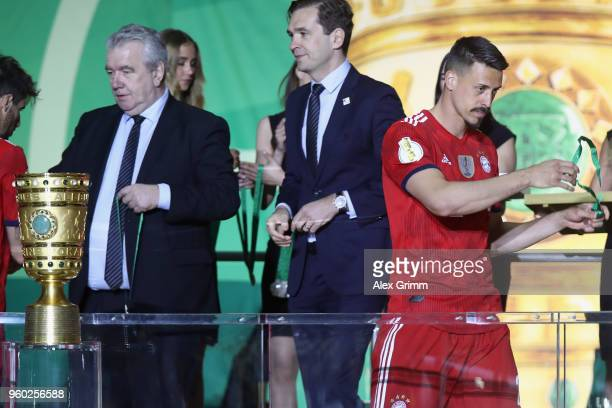 Sandro Wagner of Muenchen pulls off his silver medal after the DFB Cup final between Bayern Muenchen and Eintracht Frankfurt at Olympiastadion on May...