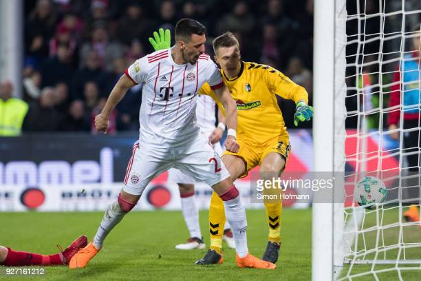 Sandro Wagner of Muenchen scores his side's third goal past goalkeeper Alexander Schwolow of Freiburg during the Bundesliga match between SportClub...