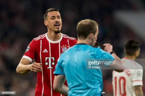 Sandro Wagner of Muenchen speaks with Referee William Collum during the UEFA Champions League quarter final second leg match between Bayern Muenchen...