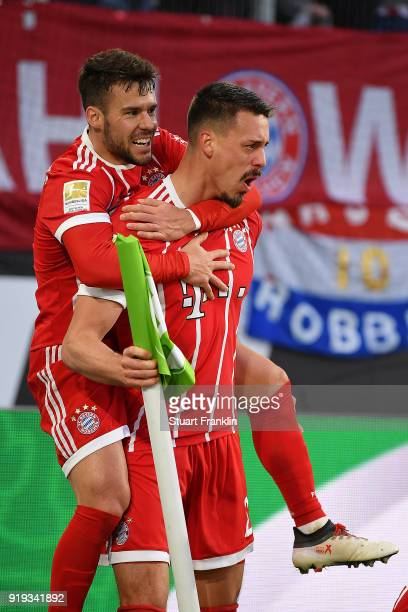 Sandro Wagner of Muenchen with Juan Bernat of Bayern Muenchen celebrates after he scored a goal to make it 11 during the Bundesliga match between VfL...