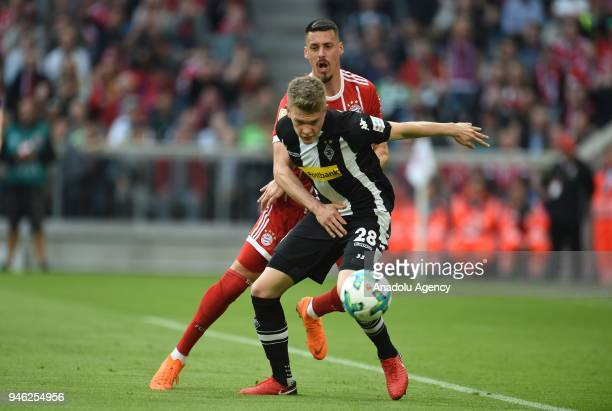 Sandro Wagner of Munich and Matthias Ginter of Borussia Monchengladbach vie for the ball during the German Bundesliga soccer match between FC Bayern...