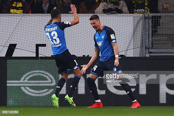 Sandro Wagner of TSG 1899 Hoffenheim celebrates scoring his teams second goal of the game with Kerem Demirbay during the Bundesliga match between TSG...