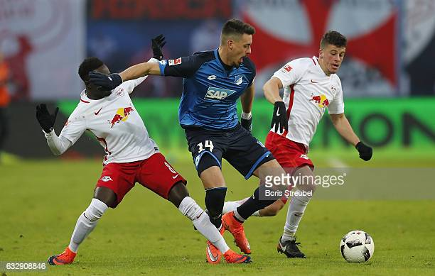 Sandro Wagner of TSG Hoffenheim is challenged by Diego Demme and Naby Keita of RB Leipzig during the Bundesliga match between RB Leipzig and TSG 1899...