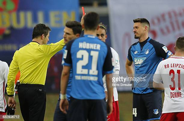 Sandro Wagner of TSG Hoffenheim is shown a red card by referee Wolfgang Stark during the Bundesliga match between RB Leipzig and TSG 1899 Hoffenheim...