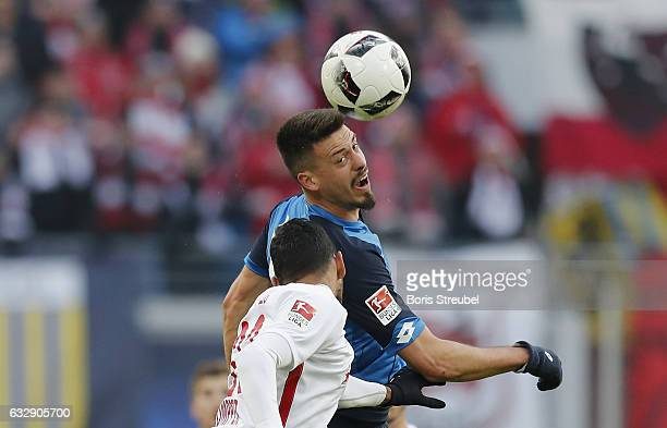 Sandro Wagner of TSG Hoffenheim jumps for a header with Marvin Compper of RB Leipzig during the Bundesliga match between RB Leipzig and TSG 1899...