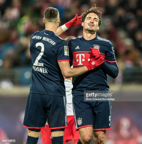 Sandro Wagner reacts with Mats Hummels of FC Bayern Muenchen during the Bundesliga match between RB Leipzig and FC Bayern Muenchen at Red Bull Arena...