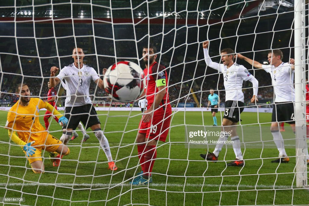 Sandro Wagner (2nd L), Thomas Mueller (2nd R) and team mate Matthias Ginter (R) of Germany celebrate the 3rd team goal during the FIFA 2018 World Cup Qualifier between Germany and Azerbaijan at Fritz-Walter-Stadion on October 8, 2017 in Kaiserslautern, Rhineland-Palatinate.