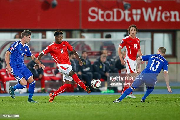 Sandro Wieser and Martin Buechel of Liechtenstein compete for the ball with David Alaba of Austria during the UEFA EURO 2016 Qualifier between...