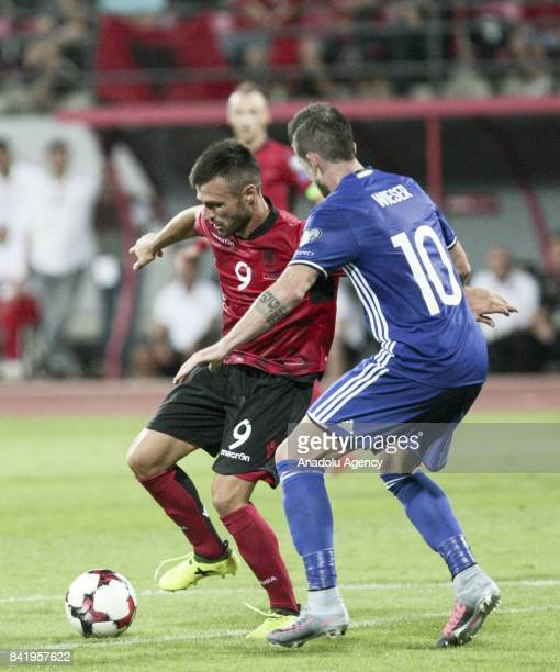 Sandro Wieser of Liechtenstein in action against Ledian Memushaj of Albania during the 2018 FIFA World Cup Qualifications Group G match between...