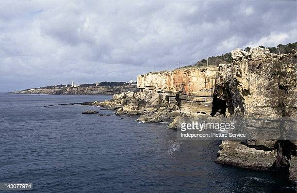 Sandstone cliffs and lighthouse at Cabo Espichel Portugal