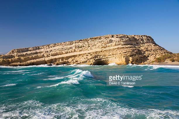 Sandstone cliffs and rough sea, Matala, Crete