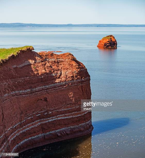 sandstone coastline - eroded stock pictures, royalty-free photos & images