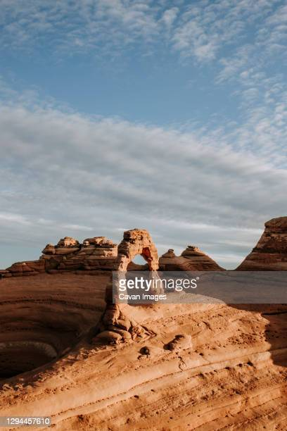 sandstone delicate arch at sunrise, arches national park, moab utah - bedrock stock pictures, royalty-free photos & images