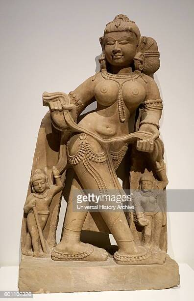 Sandstone statue of a Apsara a female spirit of the clouds and waters in Hindu and Buddhist mythology Dated 12th Century