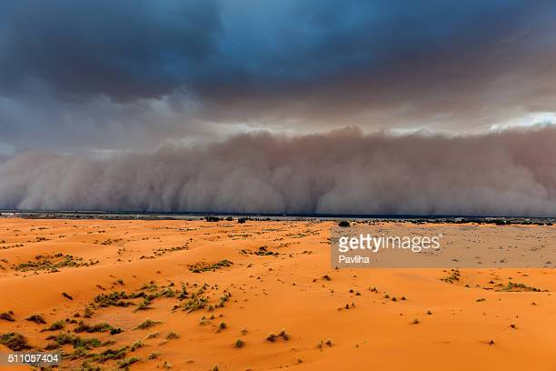 sandstorm approaching merzouga settlement,in erg chebbi desert morocco,africa - dust storm stock pictures, royalty-free photos & images