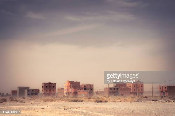 sandstorm in small town of morocco, africa - village stock pictures, royalty-free photos & images