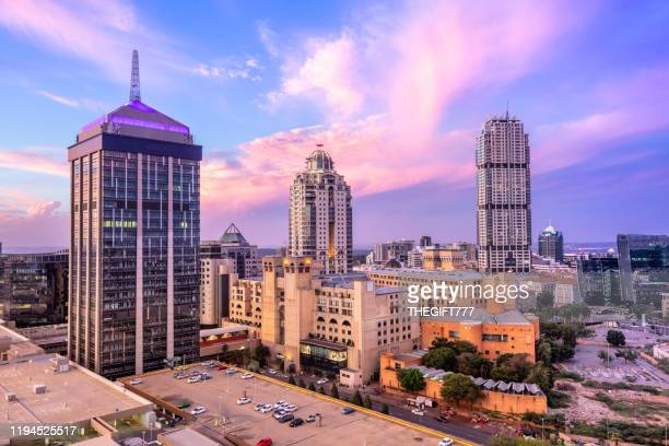 sandton city centre at sunset with nelson mandela square - gauteng province stock pictures, royalty-free photos & images