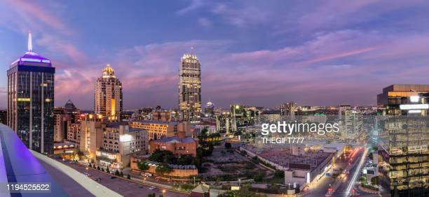 sandton city centre at sunset with nelson mandela square - sandton stock pictures, royalty-free photos & images