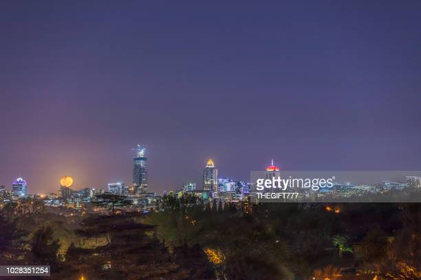 sandton city developments in the evening with a moon rising - sandton stock pictures, royalty-free photos & images