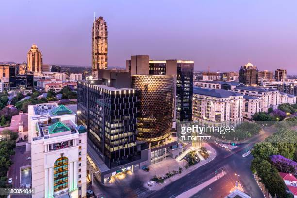 sandton city panoramic at dusk with the leonardo building - sandton stock pictures, royalty-free photos & images