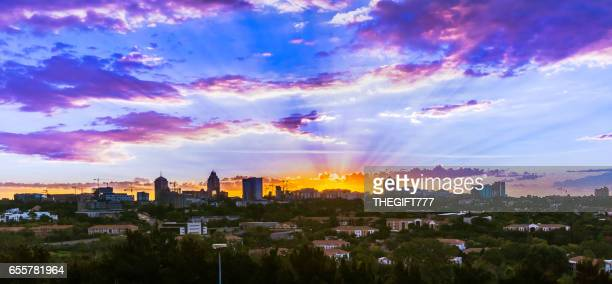 sandton city sunset skyline panorama with from wynberg - sandton stock pictures, royalty-free photos & images
