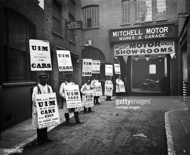 Sandwich board men advertising outside Mitchell Motors 114 Wardour Street London 1910 A line of men wearing sandwich boards advertising United...