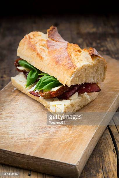 Sandwich, French white bread, smoked ham, basil, dried tomate and parmesan