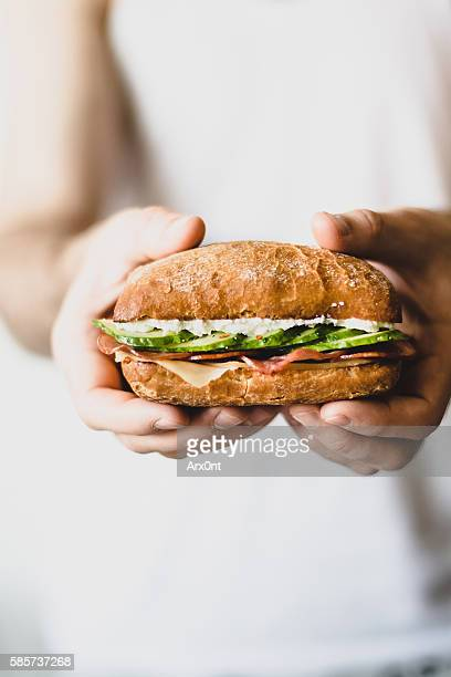 sandwich in hands - sandwich stock pictures, royalty-free photos & images