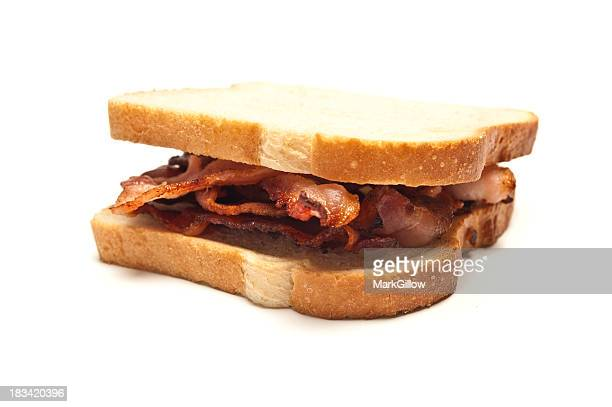 Sandwich of bacon strips between two slices of white bread