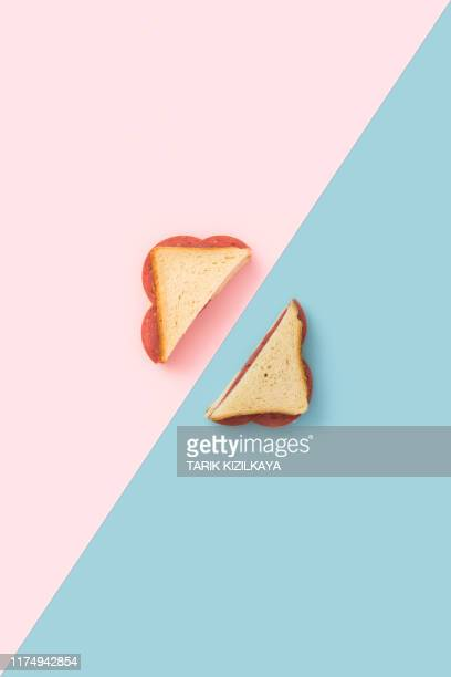 sandwich on blue and pink background - halved stock pictures, royalty-free photos & images
