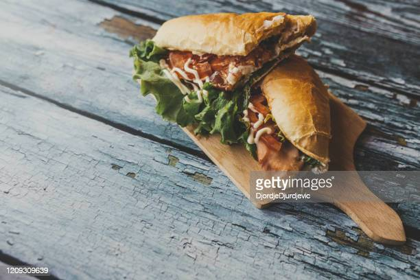 sandwich on cutting board - submarine stock pictures, royalty-free photos & images
