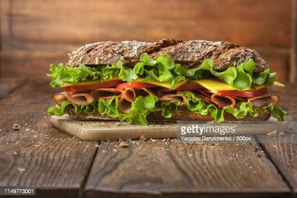 sandwich on the wooden table - baguette stock pictures, royalty-free photos & images