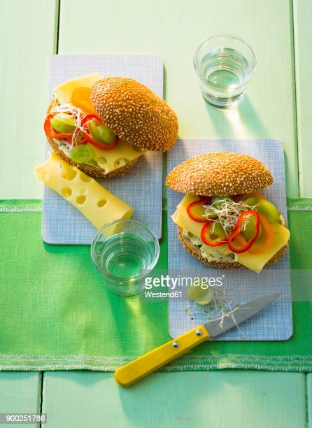 Sandwich with compound butter, cheese, green grapes bell pepper and sprouts