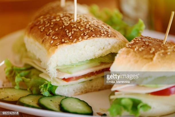 Sandwich with ham, cheese, cucumbers and tomato