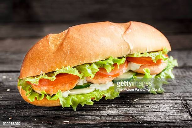 Sandwich with salmon patty and vegetables