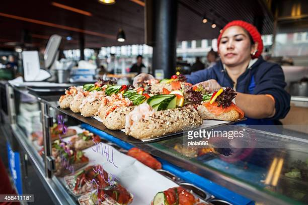 sandwich with shrimps at the fish market in bergen - bergen norway stock pictures, royalty-free photos & images