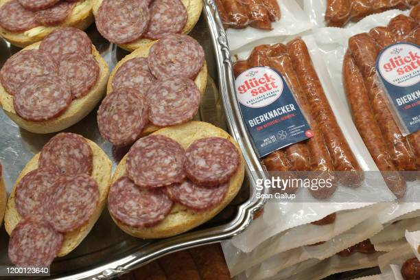 Sandwiches of bierknacker sausage lie on display and for sale at the Green Week agricultural trade fair on January 17 2020 in Berlin Germany Green...