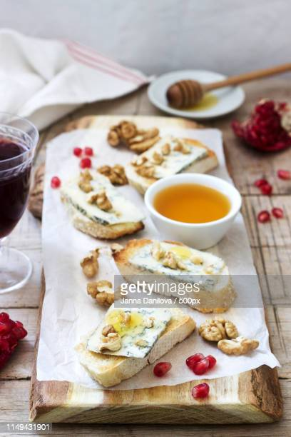 Sandwiches With Blue Cheese, Pomegranate, Honey And Nuts Served With Red Wine Rustic Style