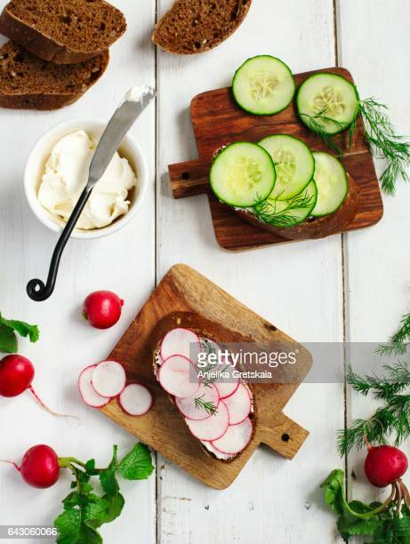 Sandwiches with fresh radishes and cucumbers