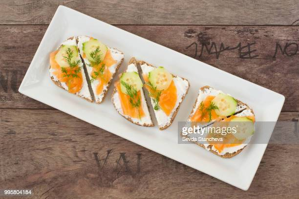 Sandwiches with salmon, ricotta, dill and cucumber