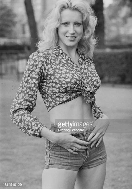Sandy Bailey wearing a tied cropped top and denim hot pants, UK, 8th May 1974.