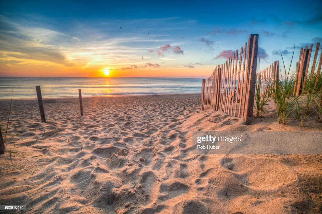 Sandy beach and Atlantic Ocean at sunrise, Outer Banks, North Carolina, USA : Stock Photo