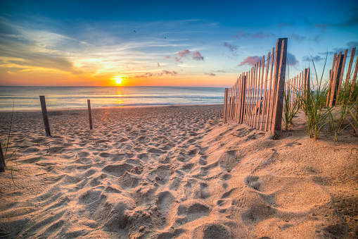 Sandy beach and Atlantic Ocean at sunrise, Outer Banks, North Carolina, USA - gettyimageskorea