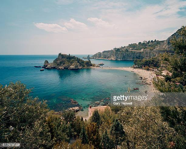 sandy beach and cove by taormina - taormina stock pictures, royalty-free photos & images